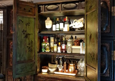 An antique cabinet converted into a bar