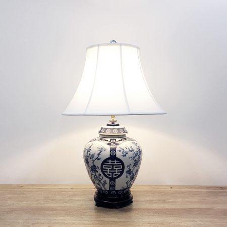 A round ceramic table lamp with a white base with blue & white double happiness and floral designs