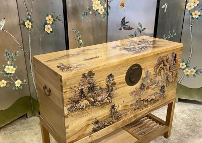 Painted camphor chest on stand and a silver leaf painted room divider